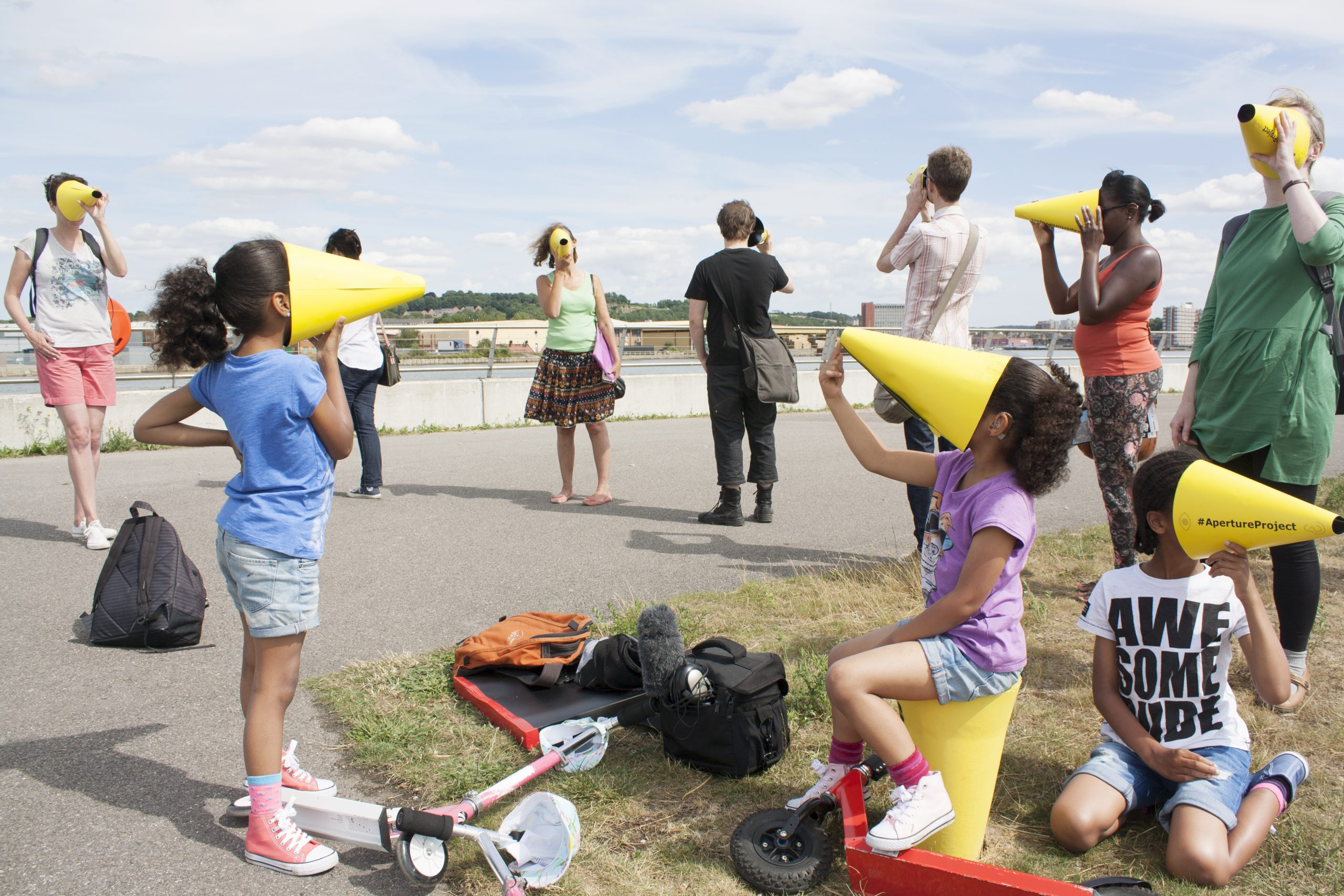 Children with yellow cones on their faces