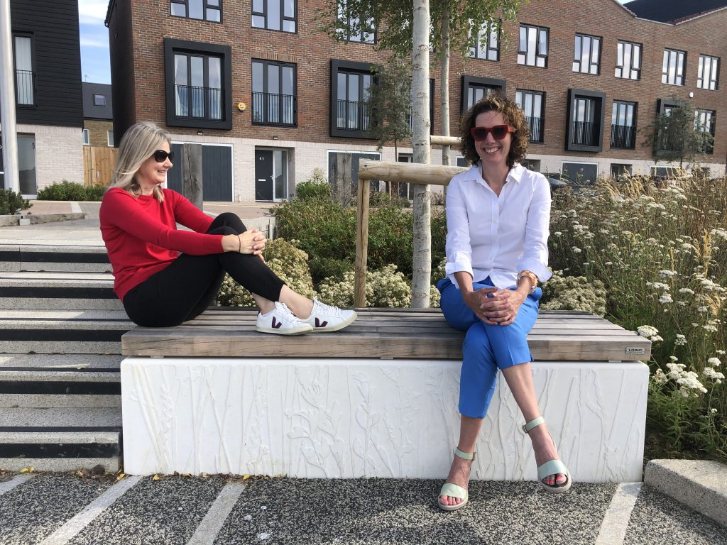 Laura and Louise sitting on a bench at Rochester Riverside