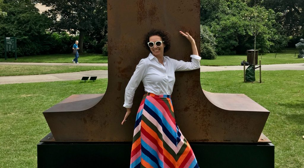 Louise in front of a large scale Corten steel number 1