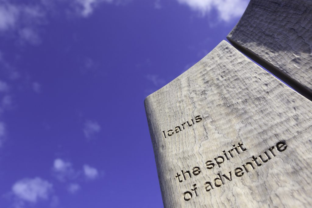 text on sculpture that reads Icarus, the spirit of adventure