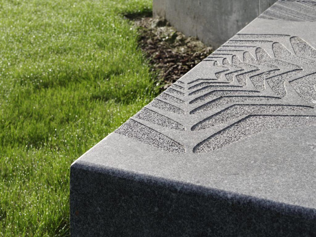 granite seat with sandblasted pattern detail