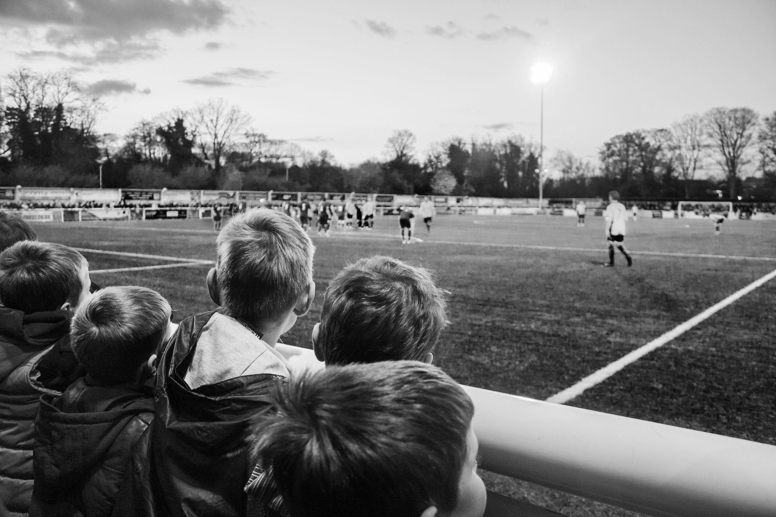 Inspired little boys watching football