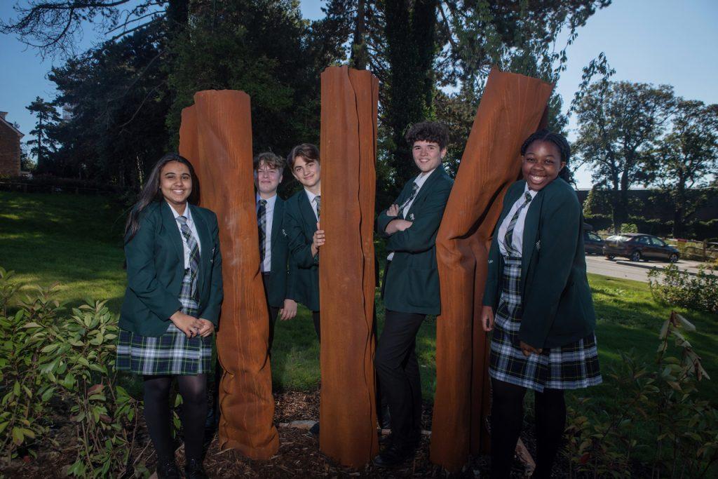 Valley Park pupils standing in between sculptures