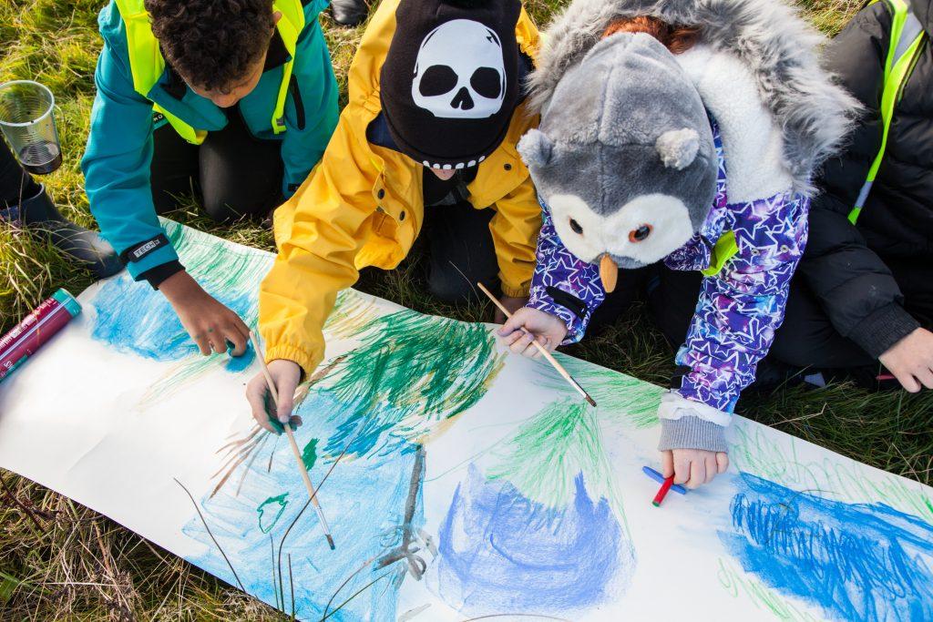 school children drawing with chalks
