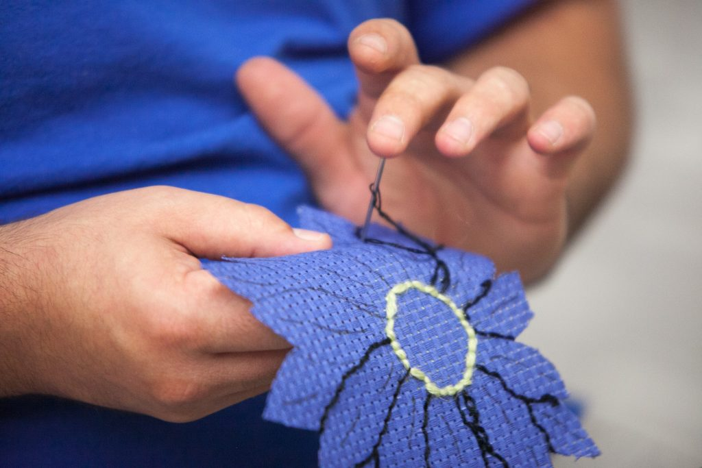 close up of someone sewing