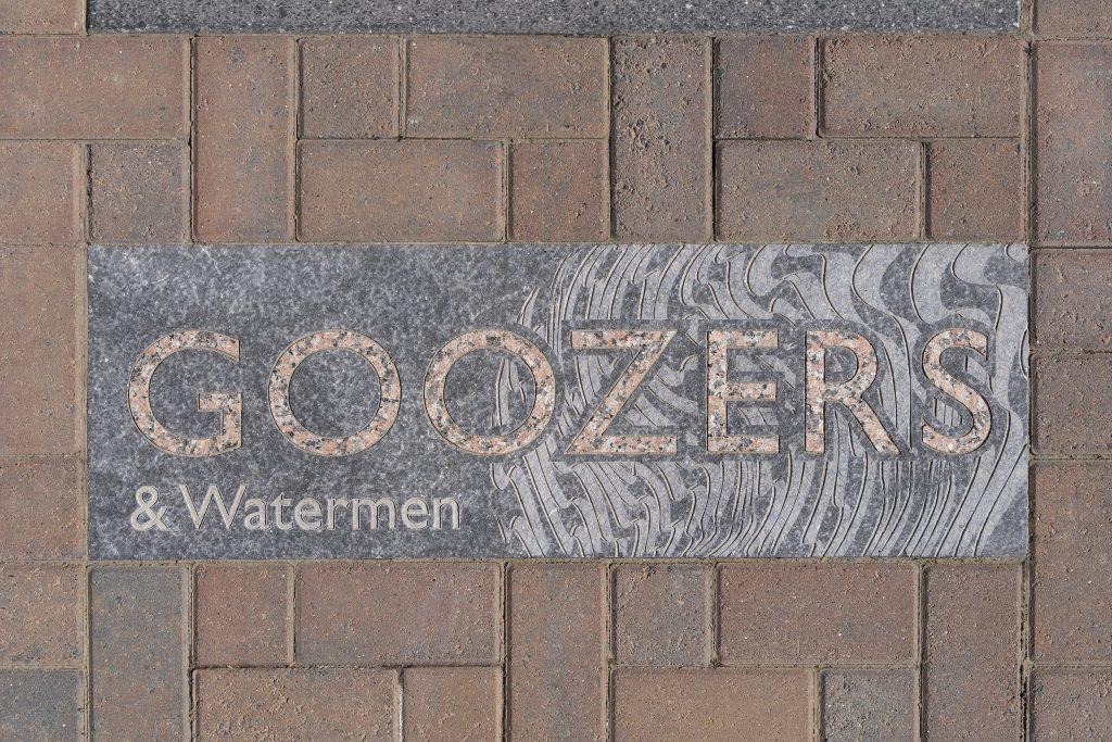 detail of bespoke granite unit in block paving