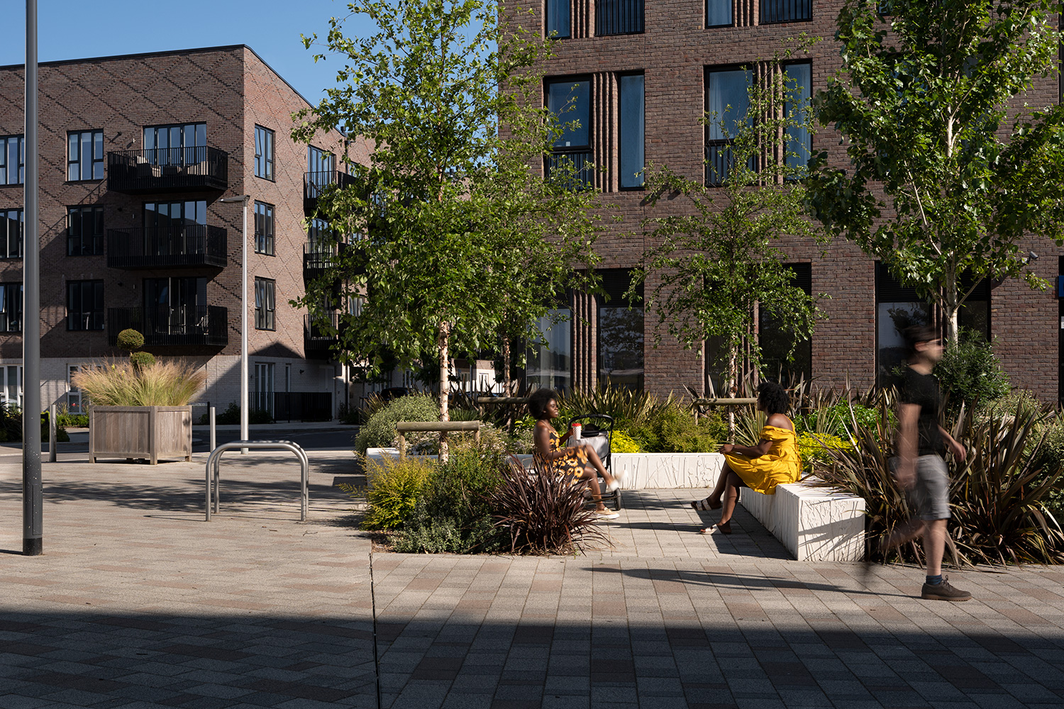 people sitting on benches at Rochester Riverside