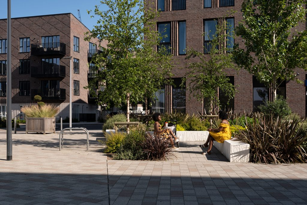 People sitting on benches in Rochester Riverside